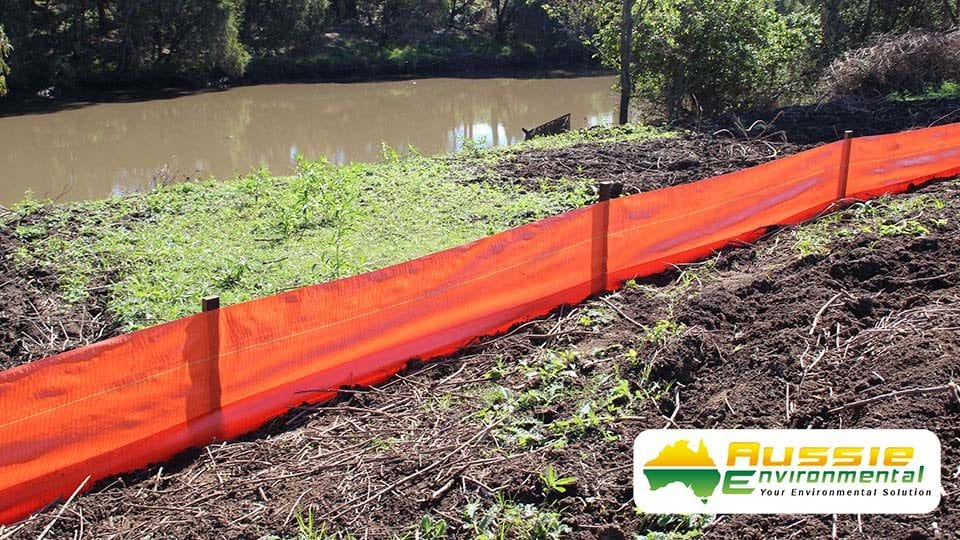 Silt Fence Installation Along River Bank