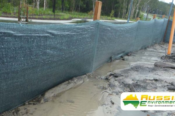 Green silt fence holding silt and sediment for erosion control